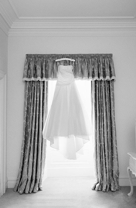 bride wedding dress hanging up