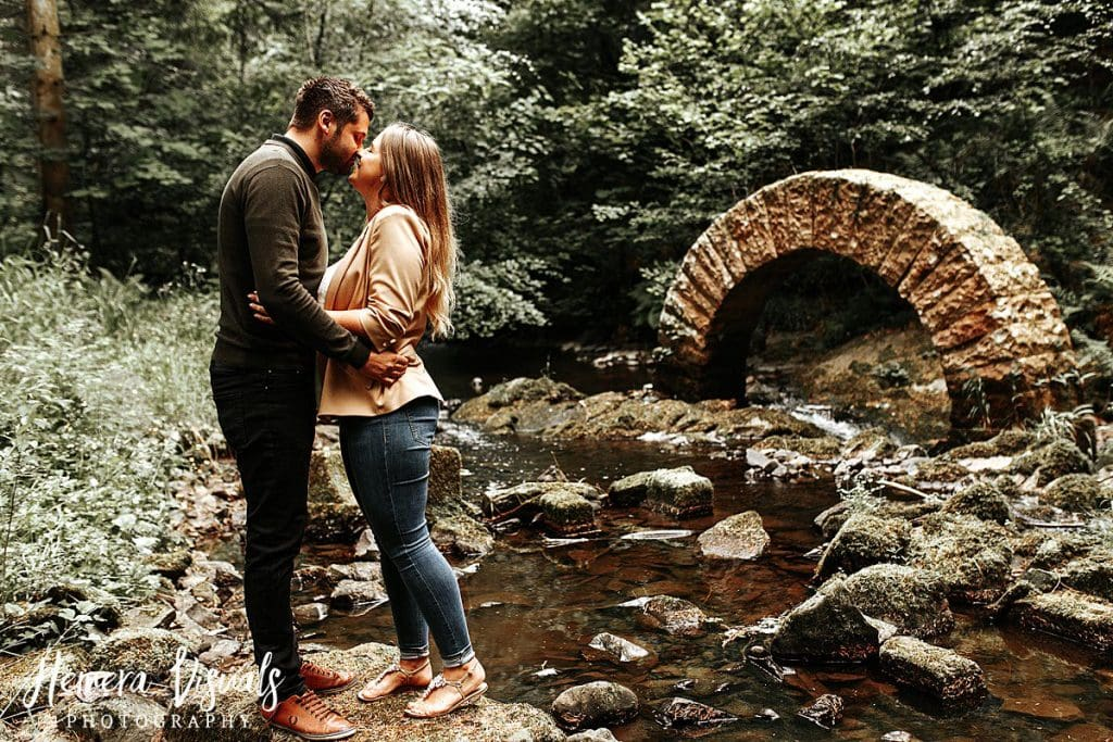 Drumlanrig castle striding arch couple engagement