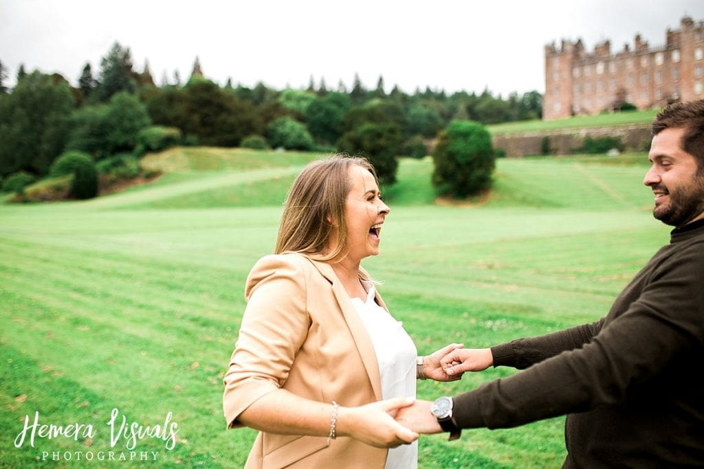 Drumlanrig castle couple engagement shoot lauging