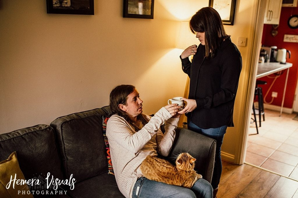 Home engagement shoot couple cat